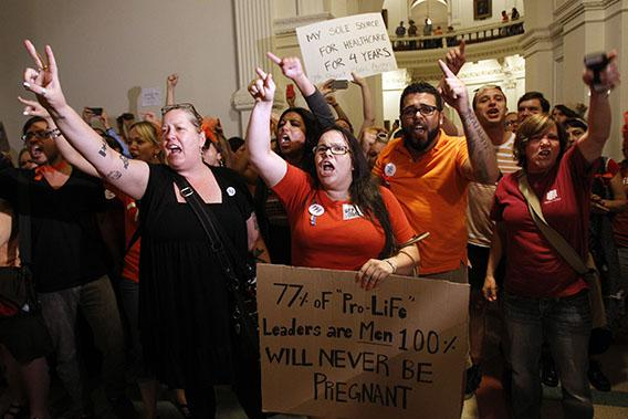 Abortion rights activists demonstrate outside the floor of the House after the HB2 bill restricting abortion rights passed in Austin, Texas July 9, 2013.