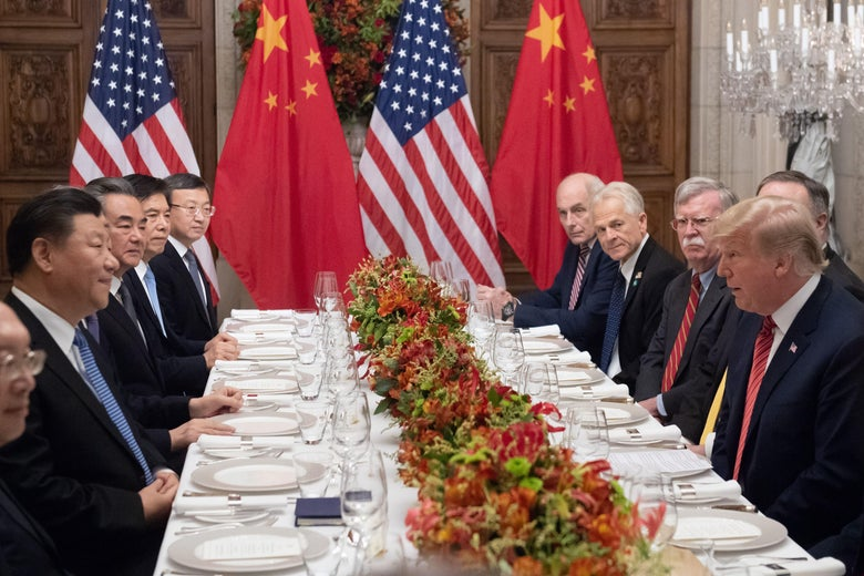 President Donald Trump and China's President Xi Jinping along with members of their delegations, hold a dinner meeting at the end of the G20 Leaders' Summit in Buenos Aires, on December 1, 2018.