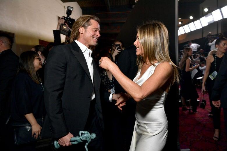Brad Pitt and Jennifer Aniston on the red carpet.