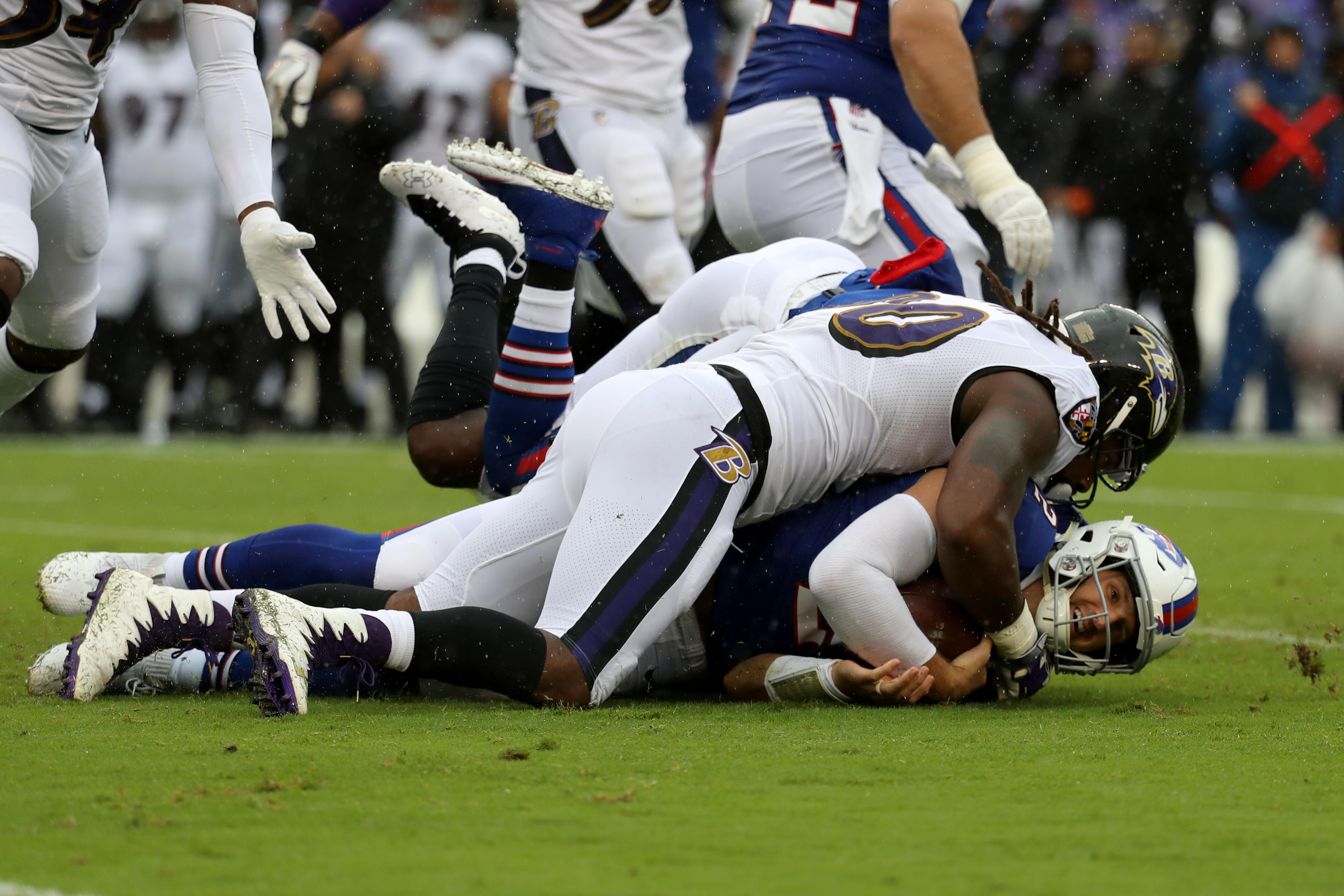 BALTIMORE, MD - SEPTEMBER 9: Nathan Peterman #2 of the Buffalo Bills is tackled by Za'Darius Smith #90 of the Baltimore Ravens in the first quarter at M&T Bank Stadium on September 9, 2018 in Baltimore, Maryland. (Photo by Rob Carr/Getty Images)