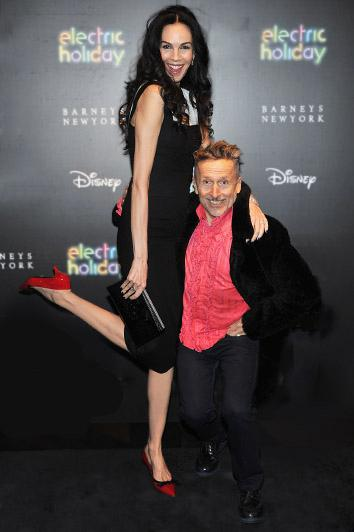 L'Wren Scott and Simon Doonan attend the Electric Holiday Window Unveiling, presented by Barneys New York and Disney, in November 2012 in New York City.