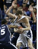 Xavier's Derrick Brown, left, grabs the jersey of Brigham Young's Trent Plaisted. Click image to expand.
