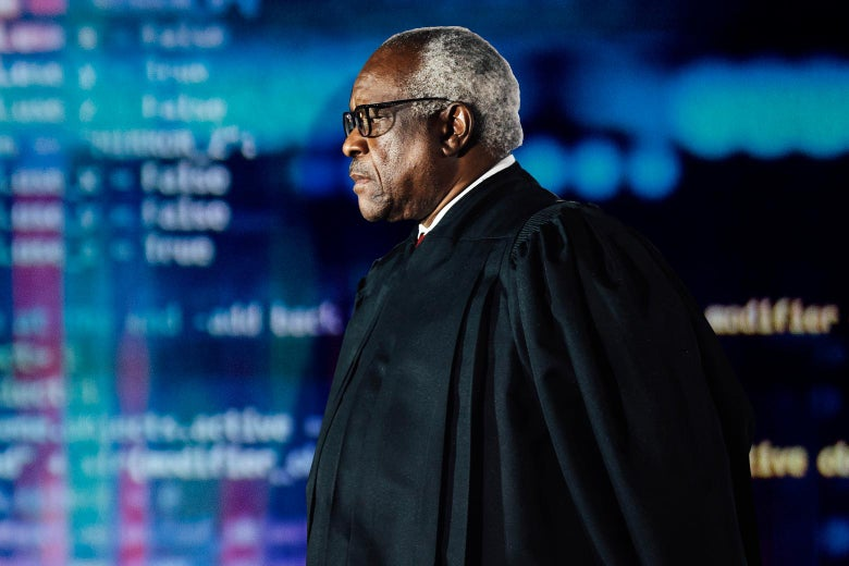 Clarence Thomas is seen against the background of a computer screen.