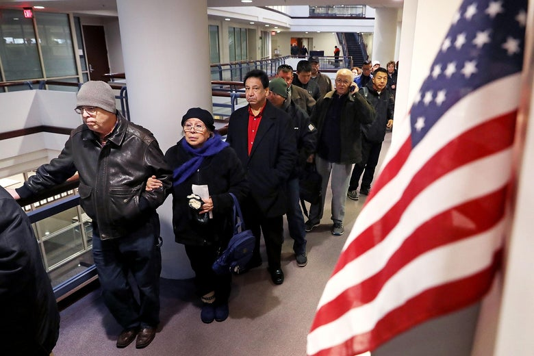 FAIRFAX, VA - DECEMBER 28:  Residents wait in line to pay taxes at the Fairfax County Government Center December 28, 2017 in Fairfax, Virginia. Many people are pre-paying their 2018 property taxes before the end of the calendar year in an attempt to blunt the effects of the new Republican tax law's $10,000 cap on deductions for state and local taxes that will disproportionately affect higher-tax, Democratic-leaning states.   (Photo by Chip Somodevilla/Getty Images)