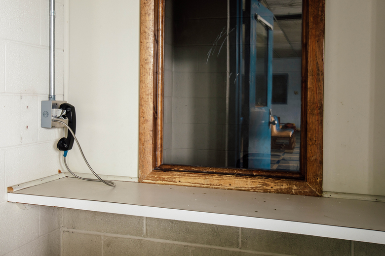 A pay phone in a prison visitation booth