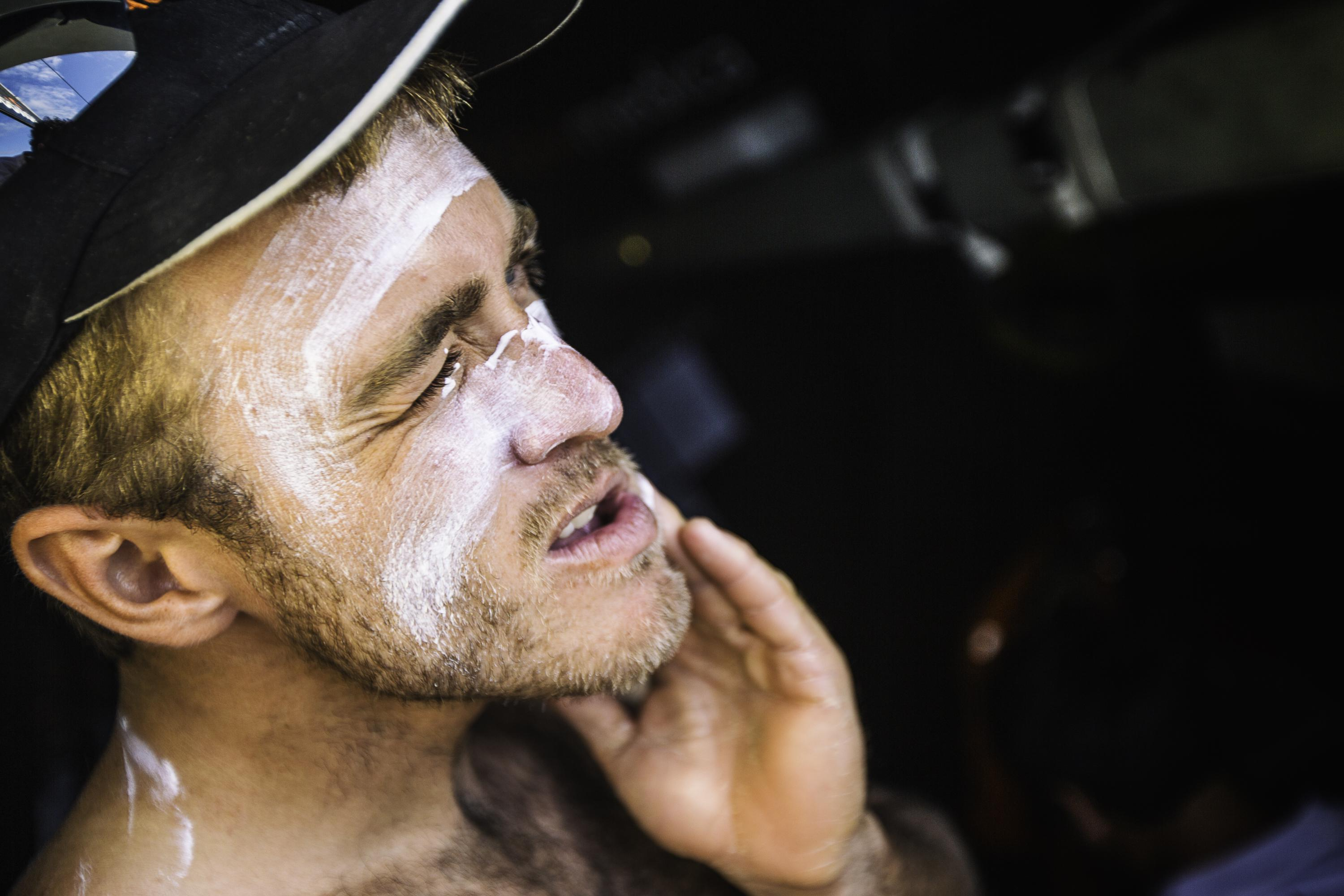 In this handout image provided by the Volvo Ocean Race, onboard Team Alvimedica. Nick Dana applying a healthy dose of sunscreen to protect his face from the intense sun of the tropics during Leg 6 from Itajai to Newport starting on April 19, 2015 in Itajai, Brazil.
