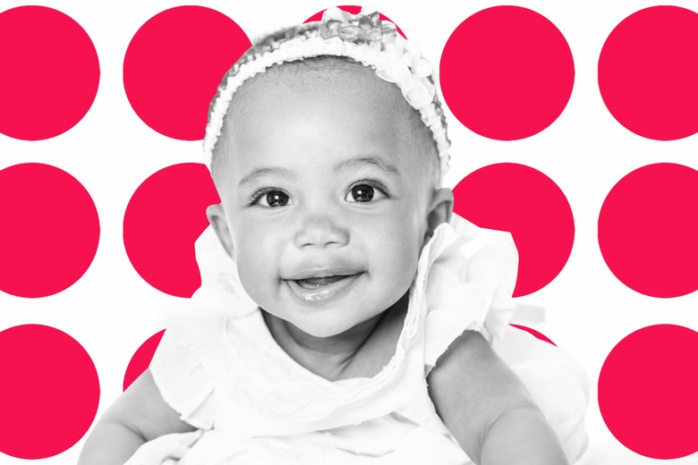A smiling biracial baby