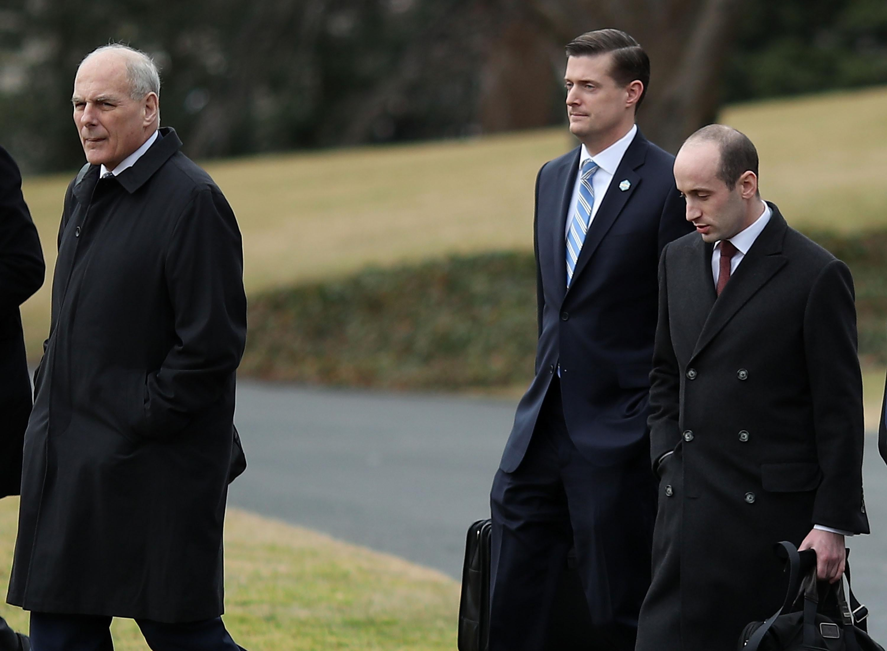 WASHINGTON, DC - FEBRUARY 01: White House chief of staff John Kelly, (L), walks with staff secretary Rob Porter, (C), and White House senior advisor Stephen Miller, before boarding Marine One to depart from the White House with President Donald Trump, on February 1, 2018 in Washington, DC. (Photo by Mark Wilson/Getty Images)
