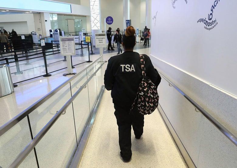 """TSA employee walking through airport """"srcset ="""" https://compote.slate.com/images/0d517fc5-6e3c-472a-8622-f14129bbb1a6.jpeg?width=780&height=520&rect= 3000x2000 & offset = 0x0 1x, https://compote.slate.com/images/0d517fc5-6e3c-472a-8622-f14129bbb1a6.jpeg?width=780&height=520&rect=3000x2000&offset=0x0 2x"""