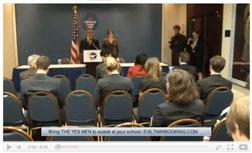 """Still from YouTube of """" The Yes Men"""" at a fake press confrence."""