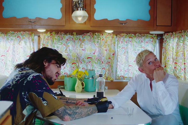 Adam Lambert gives Ellen DeGeneres a tattoo.