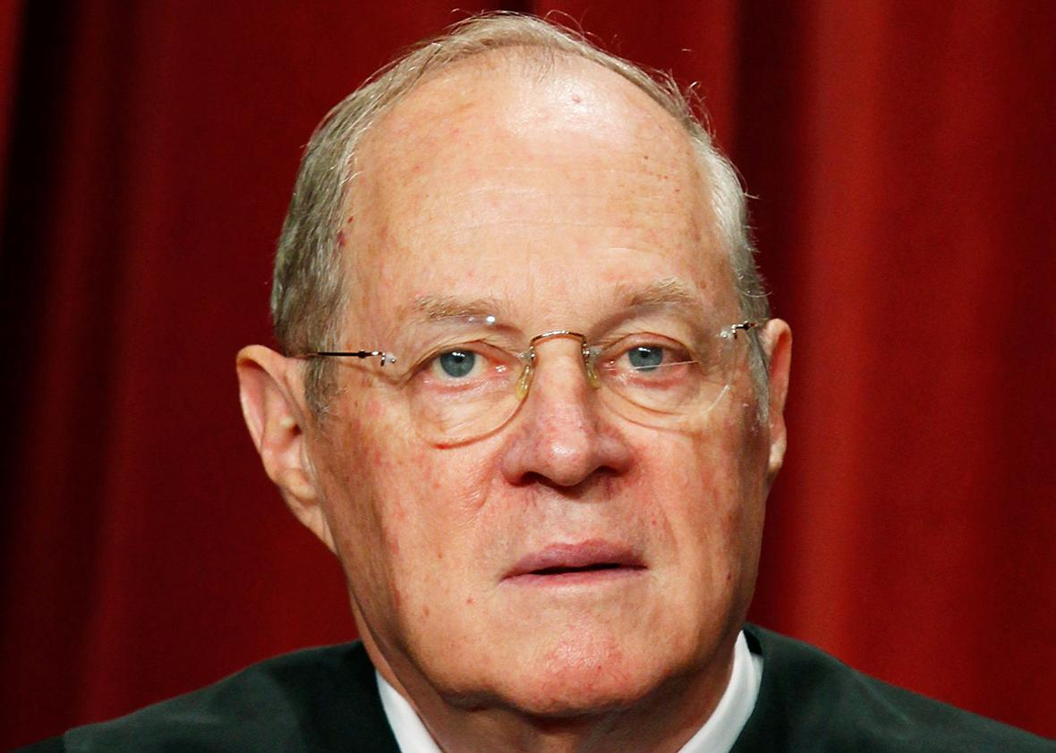 Associate Justice Anthony M. Kennedy poses during a group photograph at the Supreme Court building on September 29, 2009 in Washington, DC.