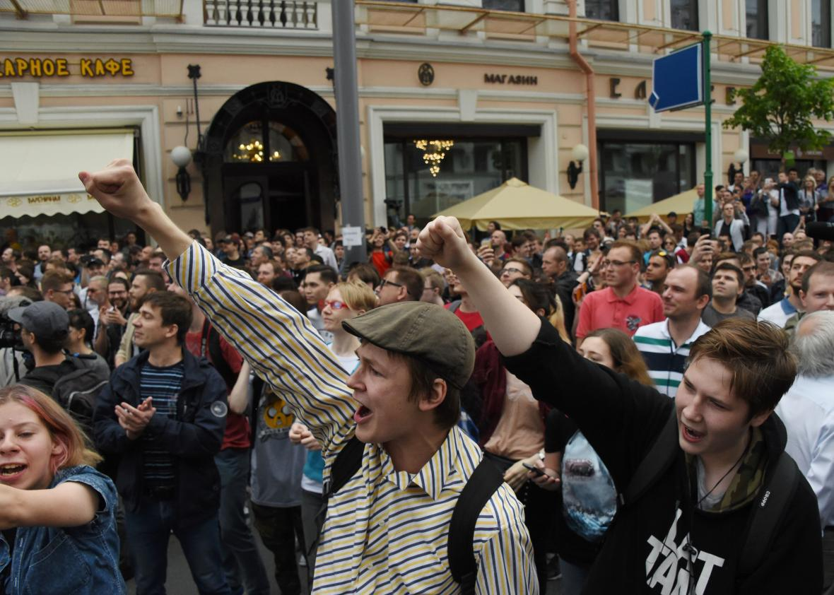 People chant slogans during an unauthorized opposition rally in Moscow on June 12, 2017.