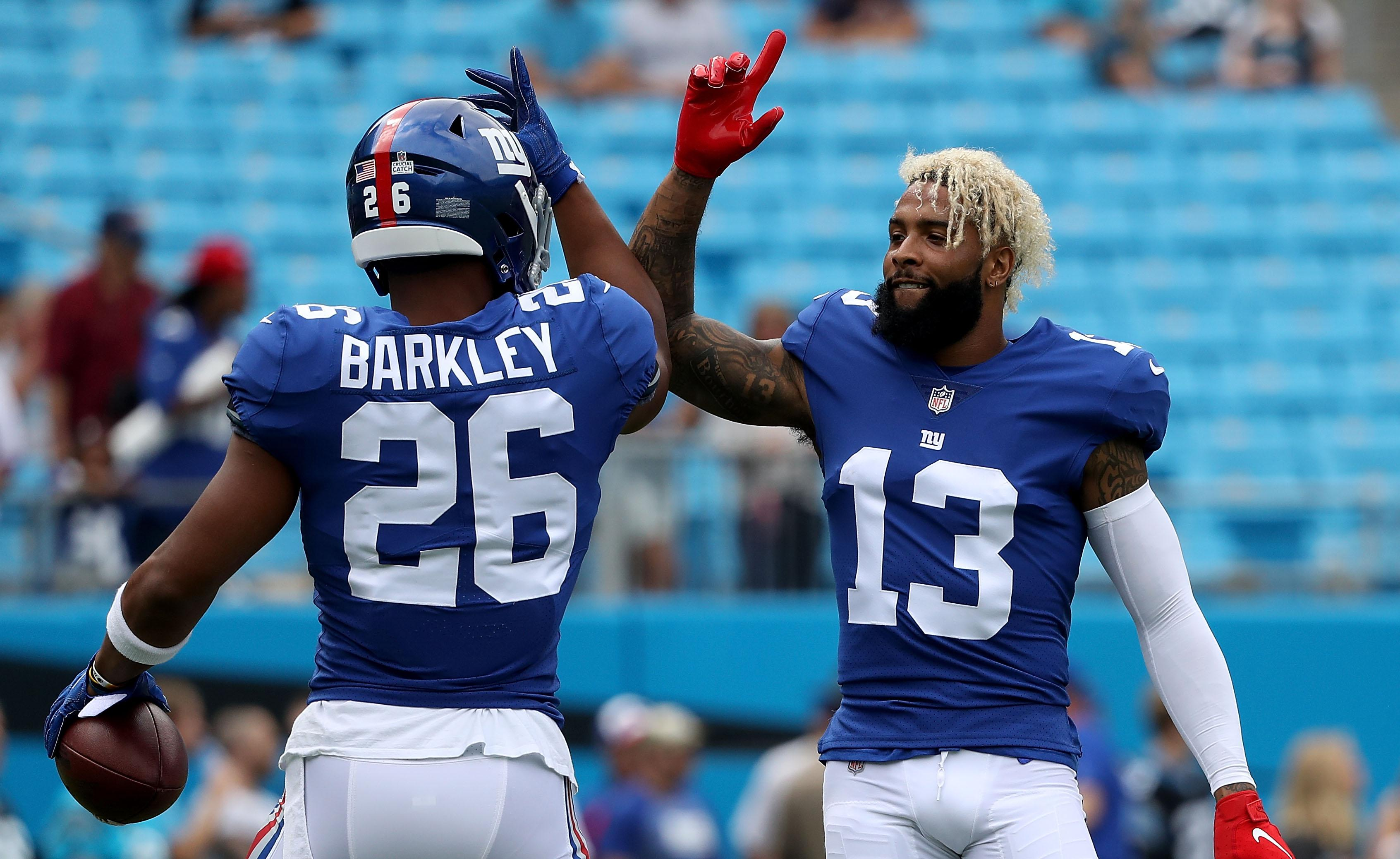 CHARLOTTE, NC - OCTOBER 07:  Odell Beckham #13 and teammate Saquon Barkley #26 of the New York Giants greet each other during warm ups against the Carolina Panthers at Bank of America Stadium on October 7, 2018 in Charlotte, North Carolina.  (Photo by Streeter Lecka/Getty Images)