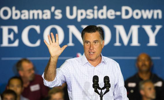 Mitt Romney waves to the crowd before delivering remarks on the economy