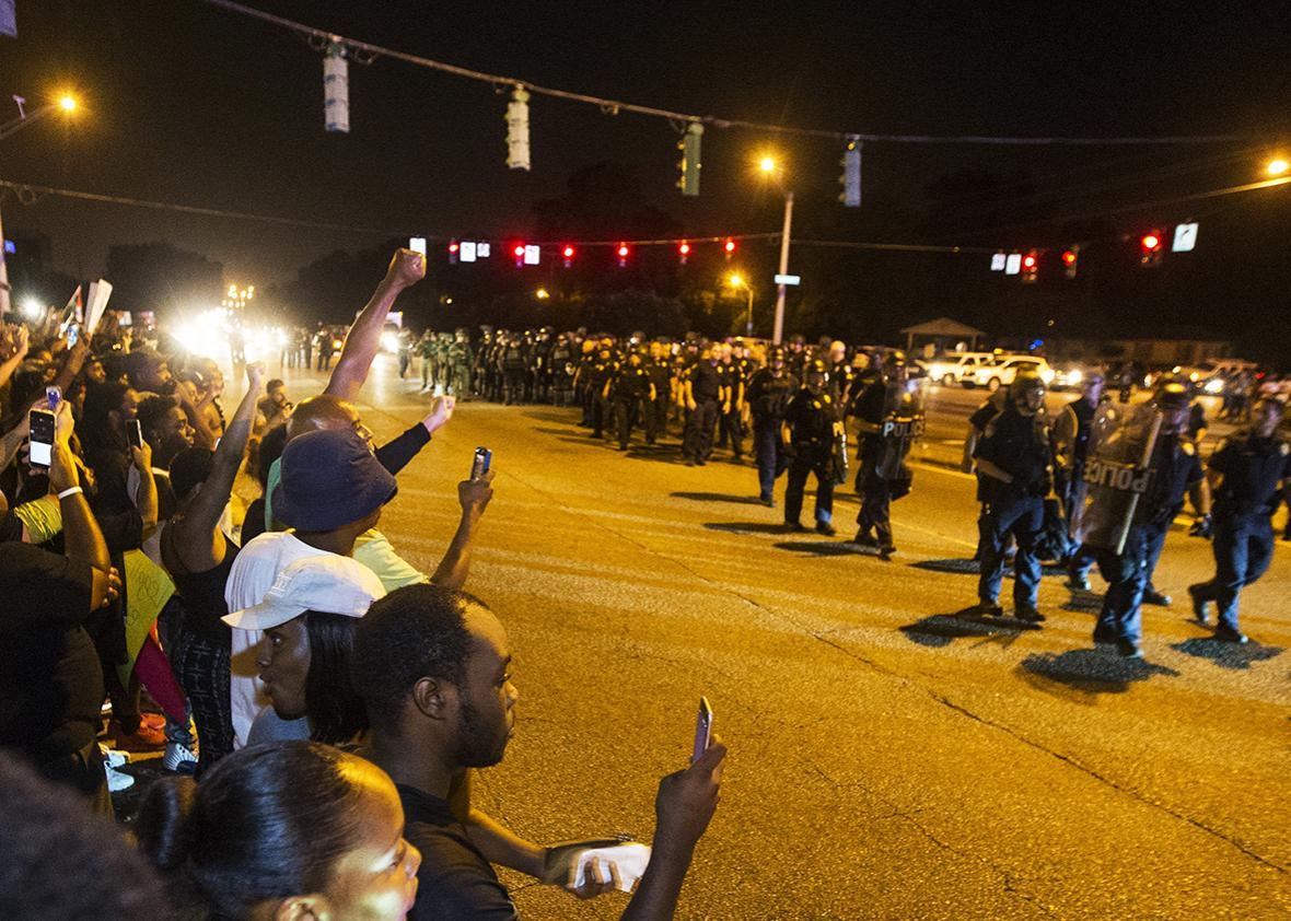 Baton Rouge police in riot gear move in on protesters for a second night in a row on July 9, 2016 in Baton Rouge, Louisiana.