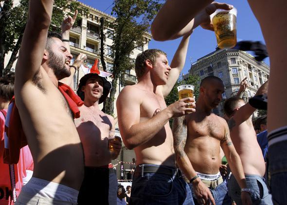 Young men drinking beer