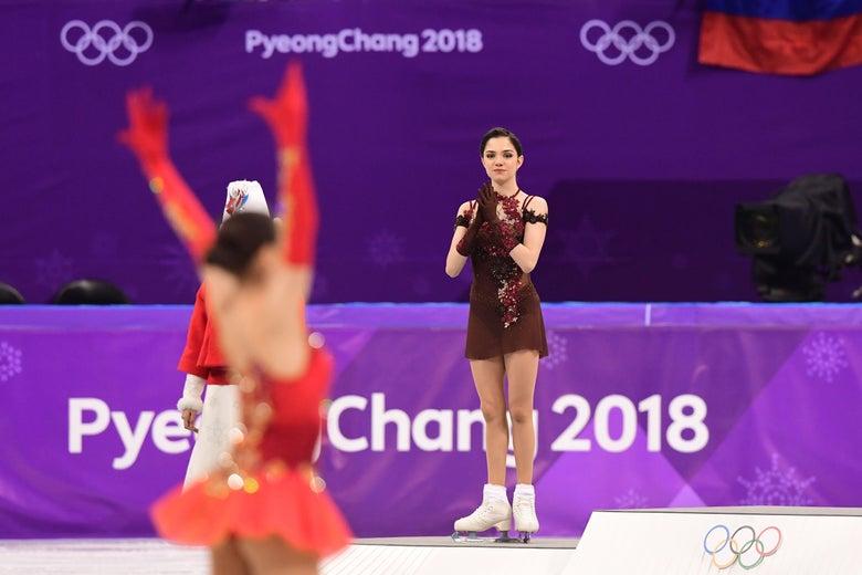 Gold medalist Russia's Alina Zagitova celebrates as silver medalist Russia's Evgenia Medvedeva claps.