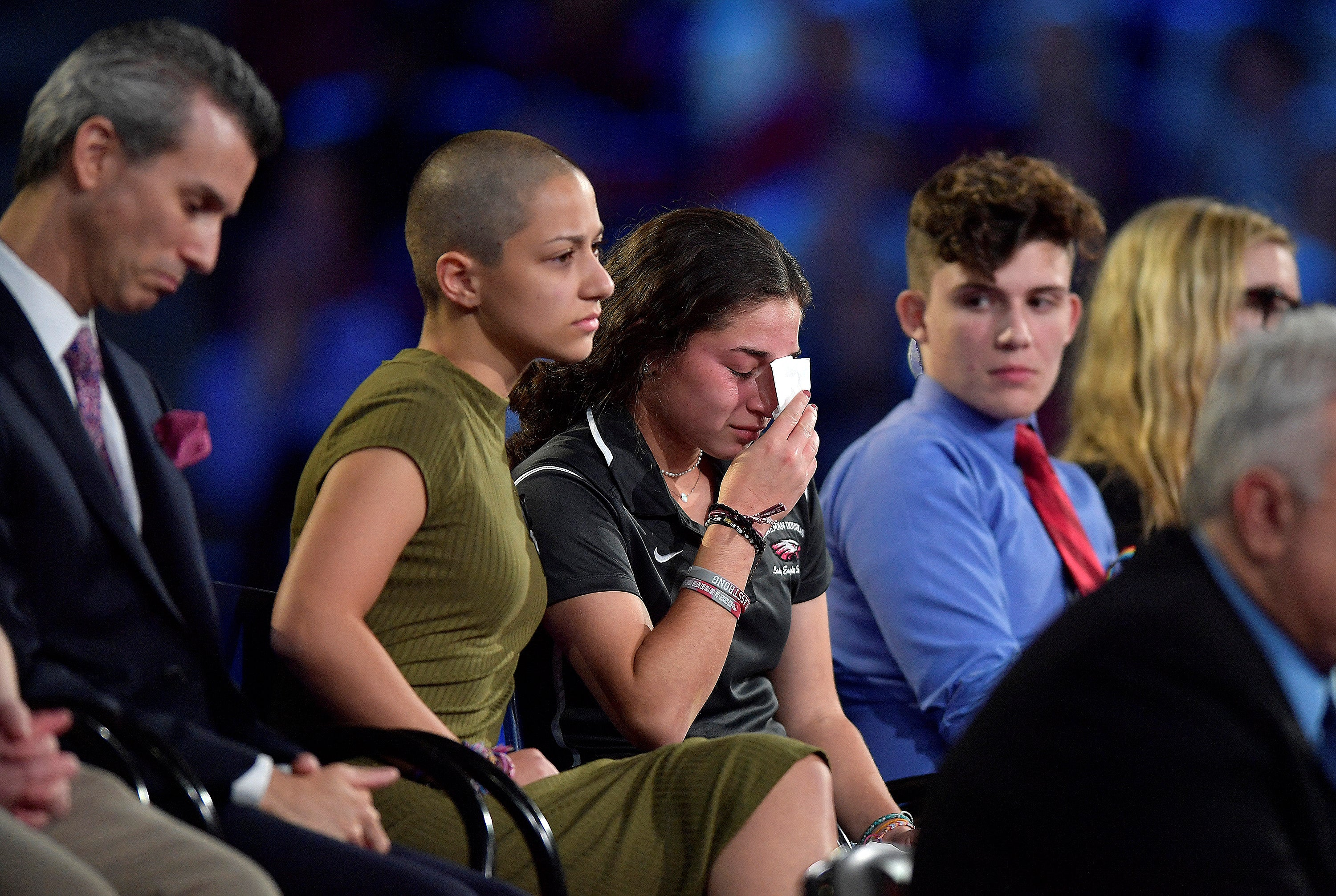 Marjory Stoneman Douglas High School student Emma Gonzalez comforts a classmate during CNN's town hall Wednesday night.