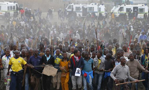 Mineworkers take part in a march at Lonmin's Marikana mine in South Africa's North West Province, Sept. 5, 2012.