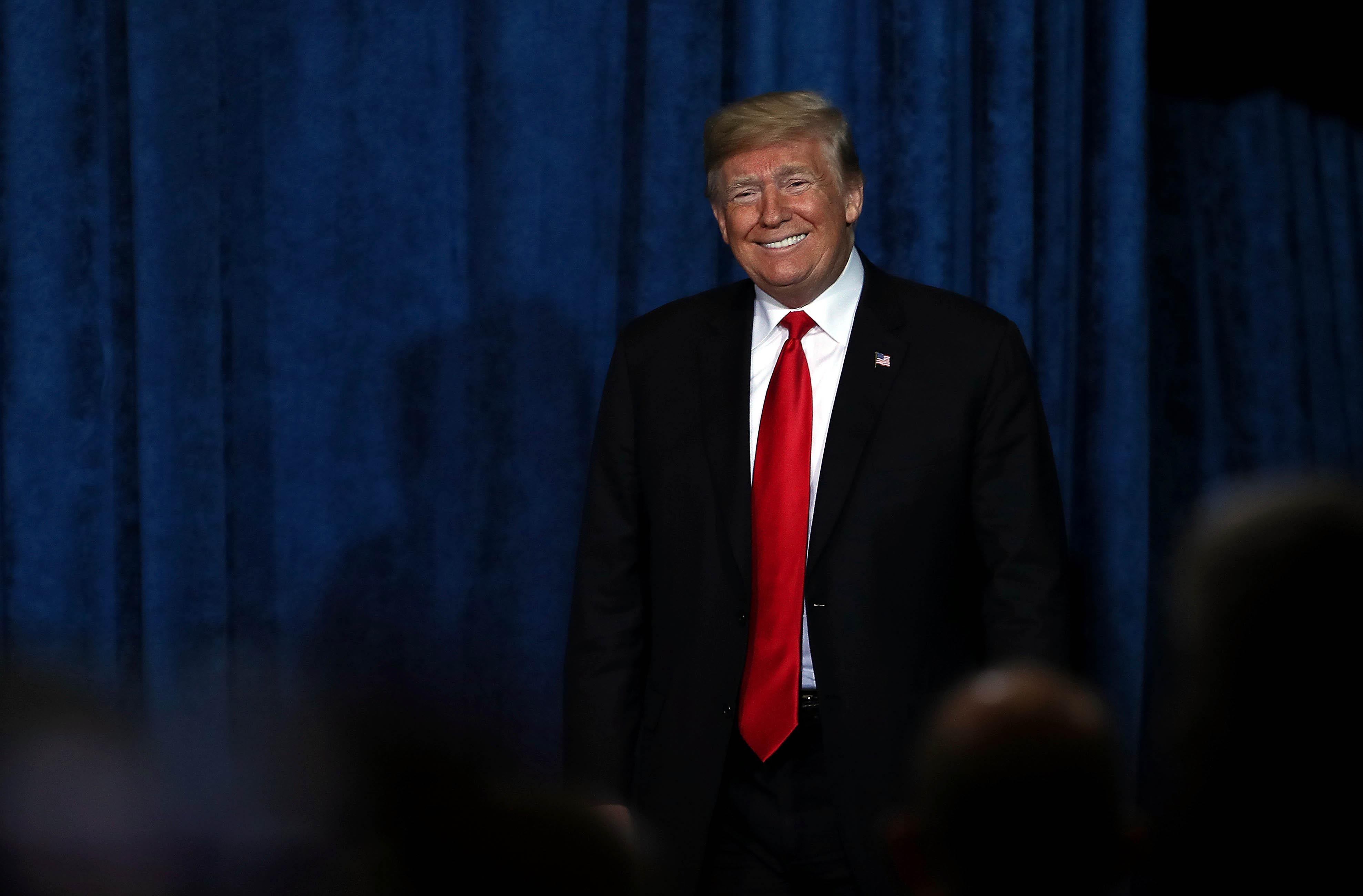 President Donald Trump smiles during the Project Safe Neighborhoods National Conference on December 07, 2018 in Kansas City, Missouri.