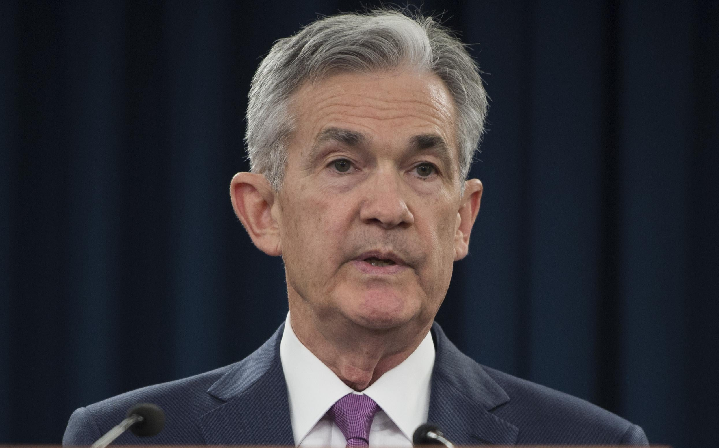 Federal Reserve Board Chairman Jerome Powell speaks during a news conference  in Washington DC on June 13, 2018. - The US Federal Reserve raised the benchmark lending rate on Wednesday, the second increase of the year, and signaled two more hikes were coming in 2018 and four in 2019, a possible sign of concern about accelerating inflation. (Photo by Andrew CABALLERO-REYNOLDS / AFP)        (Photo credit should read ANDREW CABALLERO-REYNOLDS/AFP/Getty Images)
