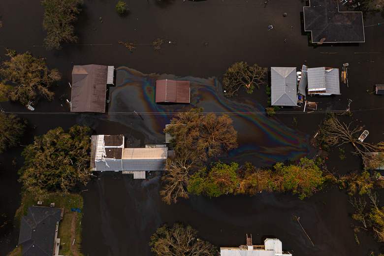 Aerial view of oil seeping out of homes into the surrounding flood water.
