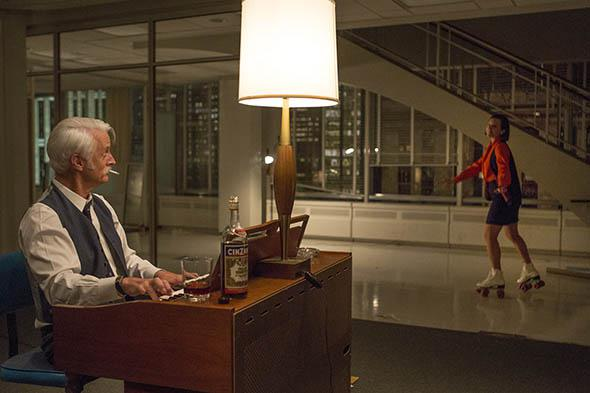 John Slattery as Roger Sterling and Elisabeth Moss as Peggy Olso