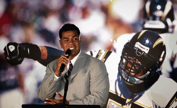 Junior Seau speaks during a press conference to announce his retirement from the NFL on August 14, 2006