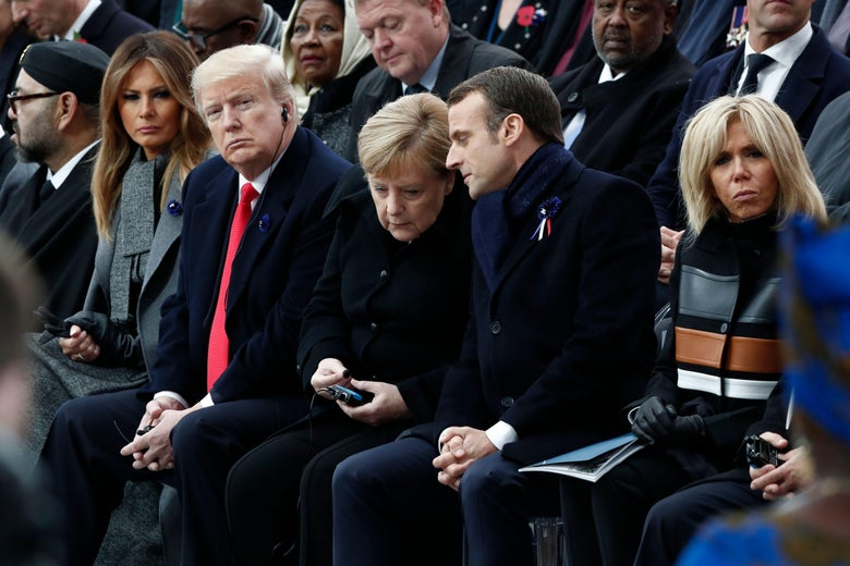 First Lady Melania Trump, President Donald Trump, German Chancellor Angela Merkel, French President Emmanuel Macron, and French President's wife Brigitte Macron attend a ceremony at the Arc de Triomphe in Paris on November 11, 2018.