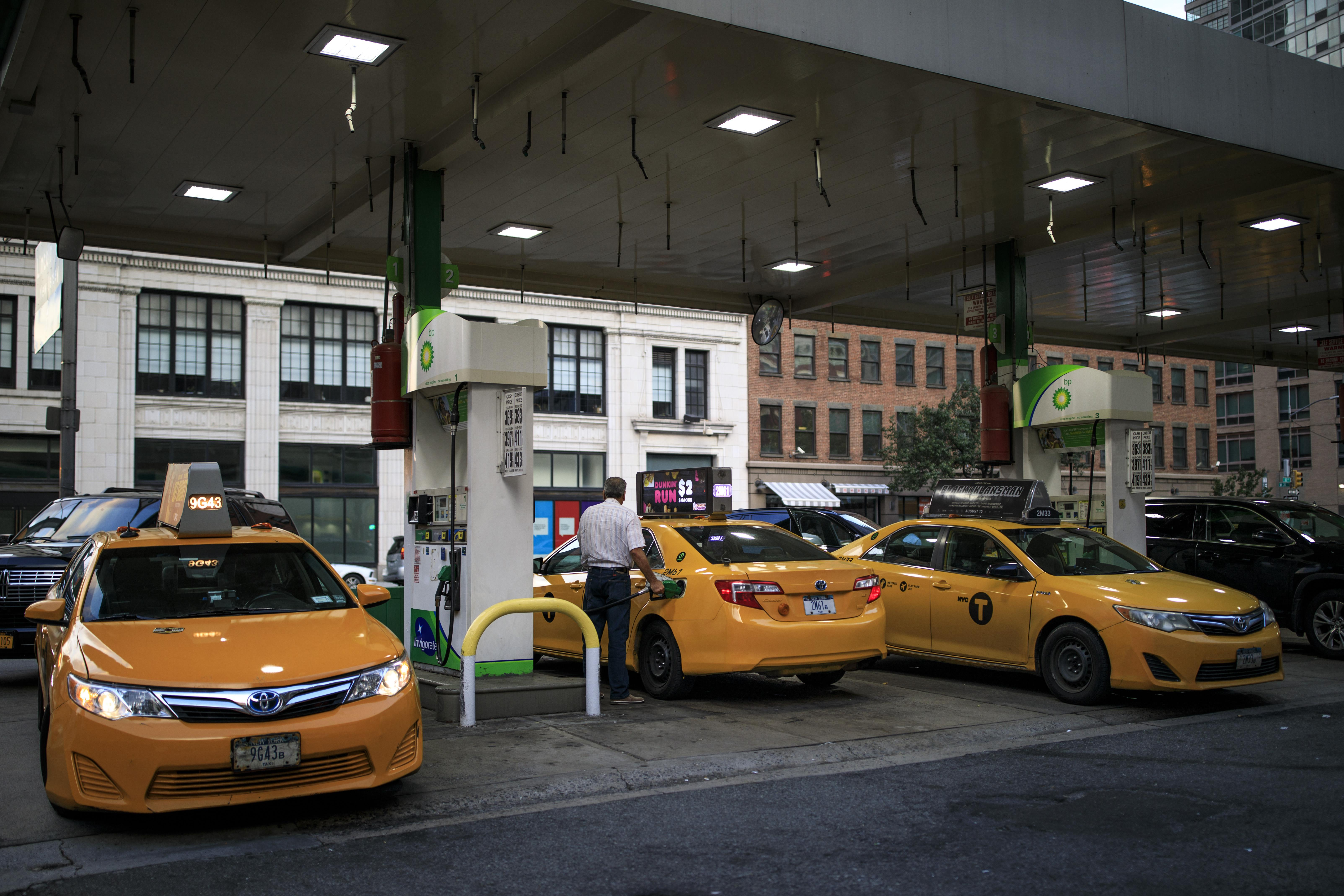 NEW YORK, NY - AUGUST 8: Taxi cabs fill up at a BP Gas station on the West Side of Manhattan, August 8, 2018 in New York City. On Wednesday, New York City became the first American city to halt new vehicles for ride-hail services. The legislation passed by the New York City Council will cap the number of for-hire vehicles for one year while the city studies the industry. The move marks a setback for Uber in its largest U.S. market. (Photo by Drew Angerer/Getty Images)