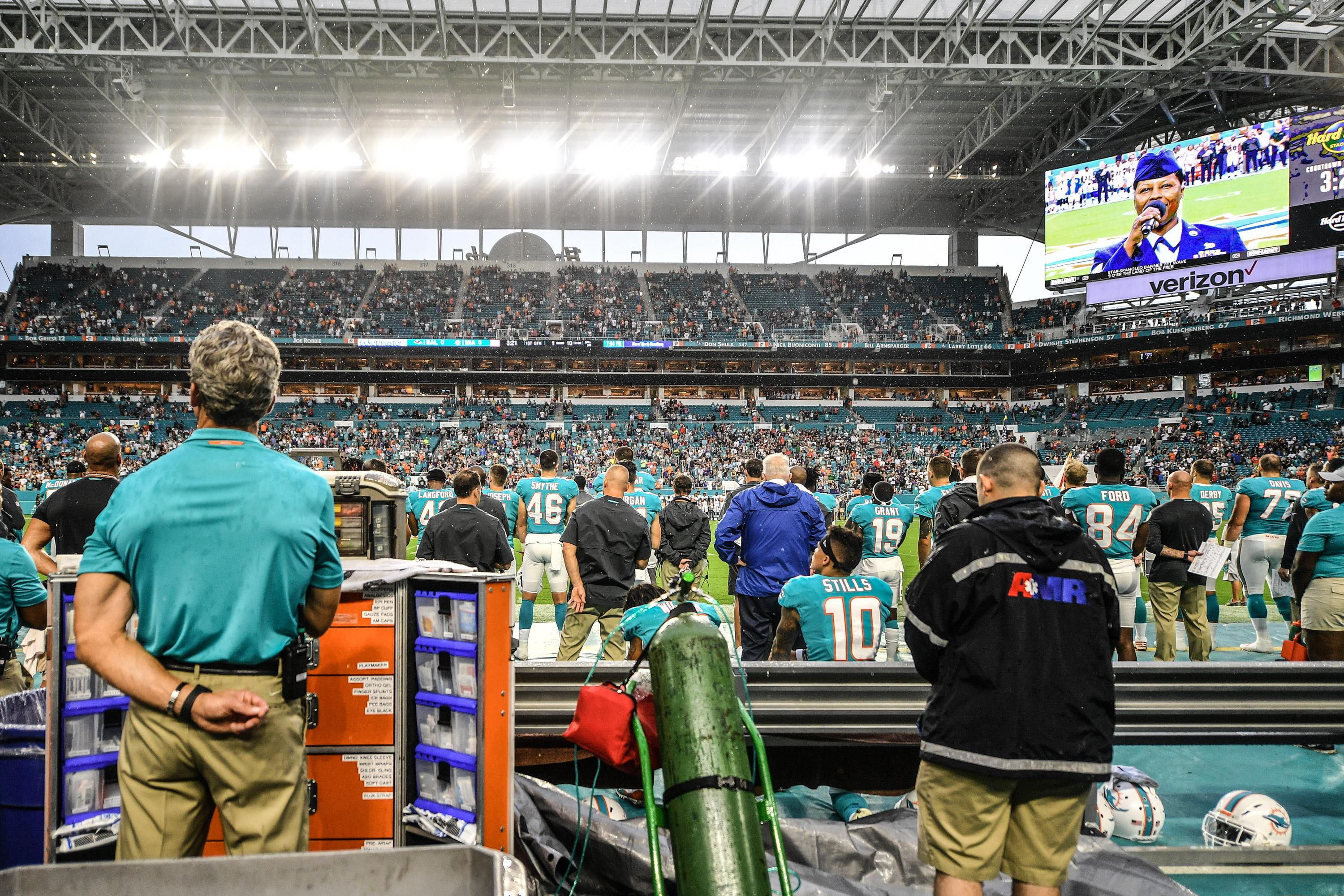 MIAMI, FL - AUGUST 25: Albert Wilson #15 and Kenny Stills #10 of the Miami Dolphins sit on the bench during the National Anthem before a preseason game against the Baltimore Ravens at Hard Rock Stadium on August 25, 2018 in Miami, Florida. (Photo by Mark Brown/Getty Images)