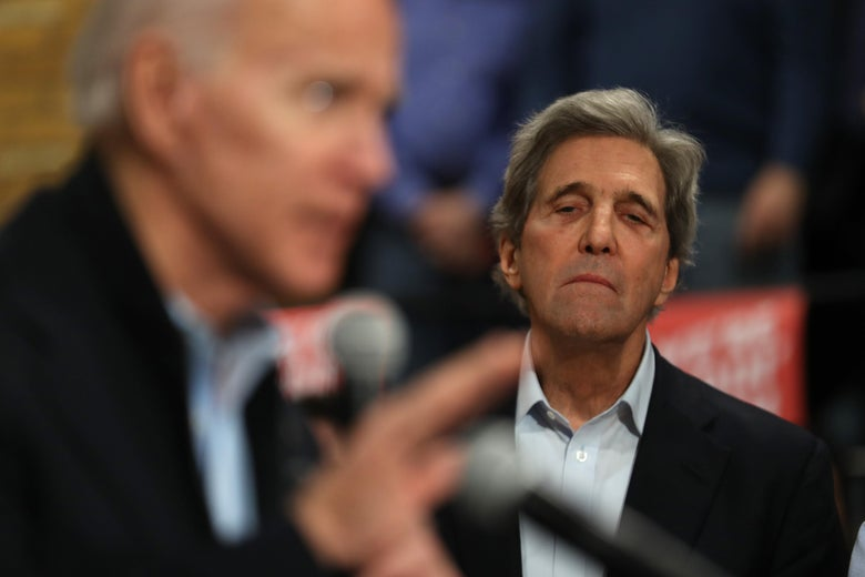 Former Secretary of State John Kerry looks on as Democratic presidential candidate former Vice President Joe Biden speaks during a campaign event on February 1, 2020 in Cedar Rapids, Iowa.