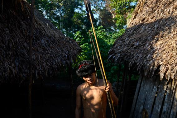 A Yanomamö native warrior poses for a picture at Irotatheri community, in Amazonas state, southern Venezuela, 19 km away from the border with Brazil, on September 7, 2012.