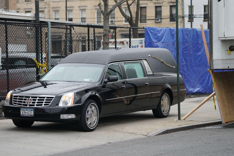 A hearse arrives to transport a body from a refrigeration truck serving as a temporary morgue outside of Wyckoff Hospital in the Bushwick section of Brooklyn April 5, 2020 in New York.
