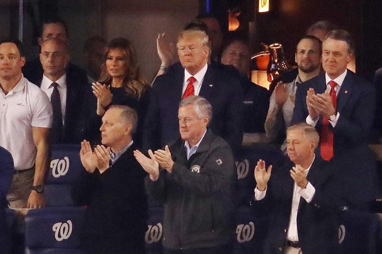 Donald Trump, Melania Trump, Lindsey Graham, and others clapping during Game Five of the 2019 World Series at Nationals Park in Washington on Oct. 27.
