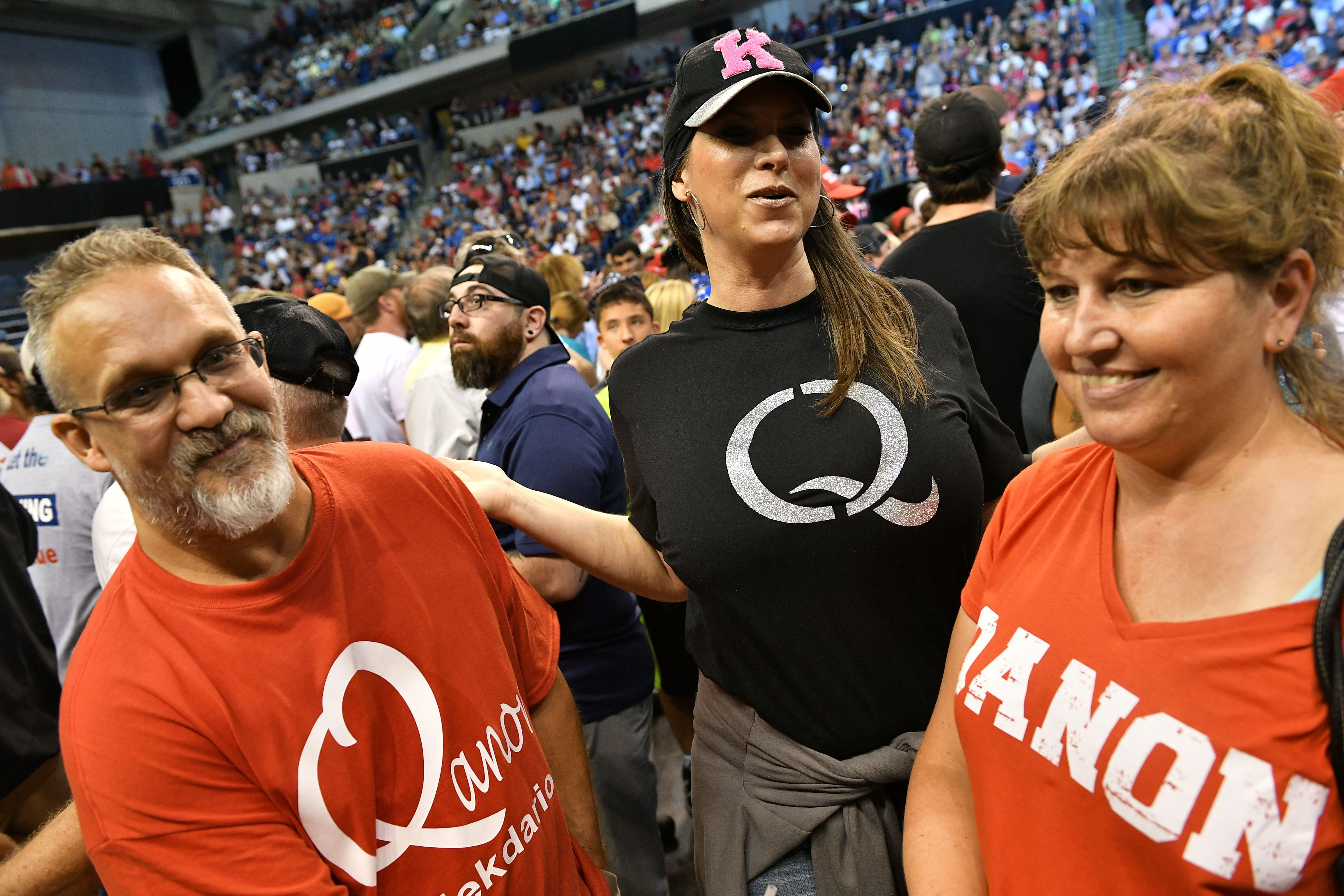 Members of QAnon await the arrival of President Donald Trump for a political rally in Wilkes-Barre, Pennsylvania on Aug. 2.