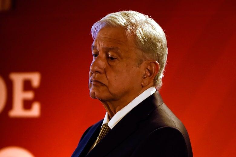 Andrés Manuel Lopéz Obrador looks down.