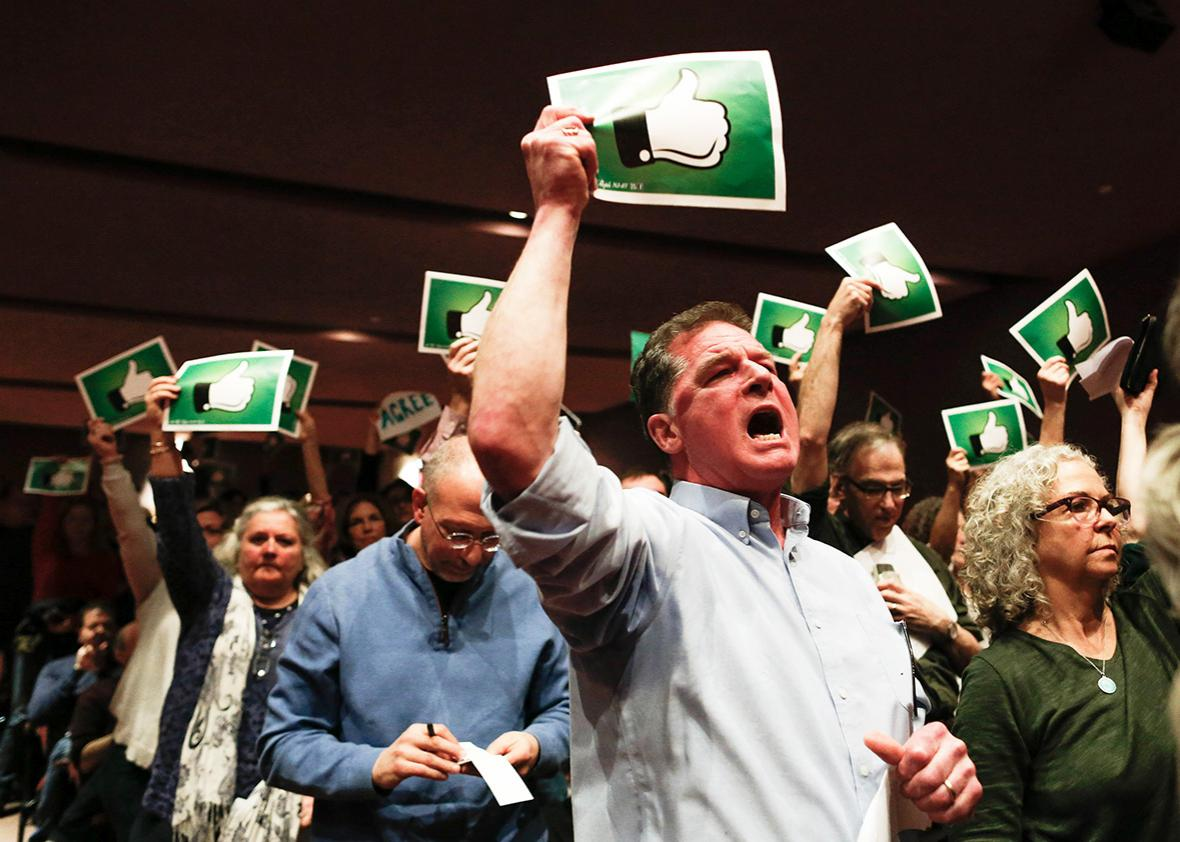 Constituents react after U.S. Congressman Leonard Lance responded to questions during a town hall event at the Edward Nash Theater on the campus of Raritan Valley Community College on February 25, 2017 in Branchburg, New Jersey.