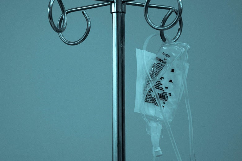 A IV bag hanging on a rack.
