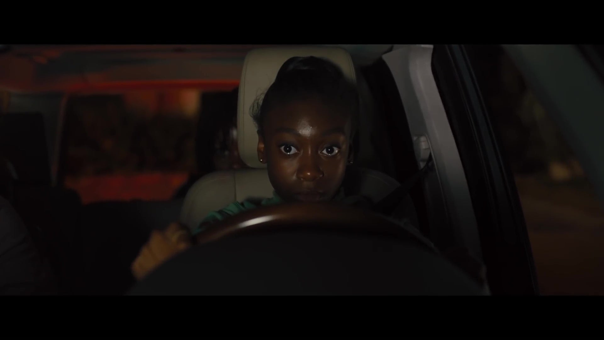 Shahadi Wright Joseph behind the wheel of a car.