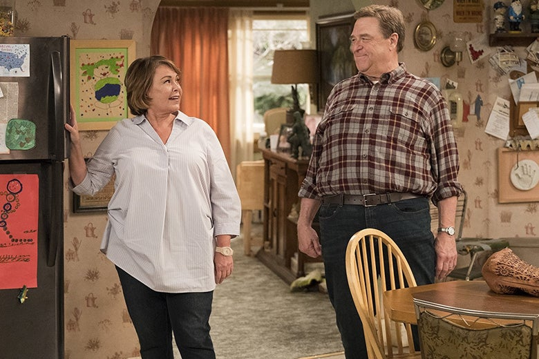 Roseanne Barr and John Goodman smile at each other on the set of the rebooted Roseanne.