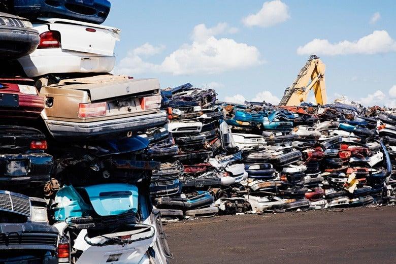 Cars in a scrap yard.