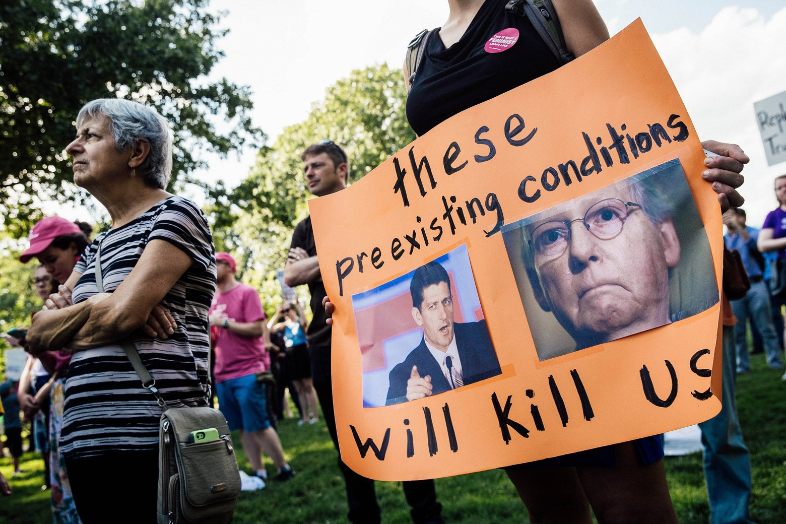 Protesters rally against the GOP health care plan on July 26, 2017.
