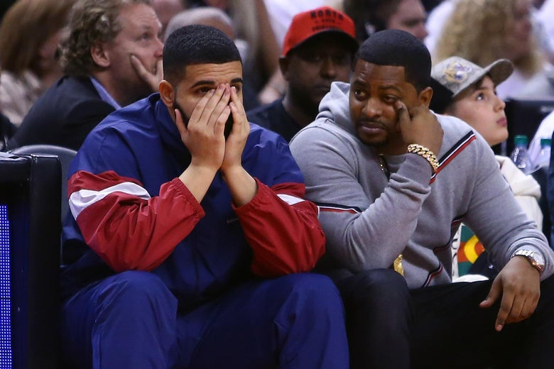 Drake looks on from his court side seat in the second half of Game Two of the Eastern Conference Semifinals between the Cleveland Cavaliers and the Toronto Raptors during the 2018 NBA Playoffs at Air Canada Centre on May 3, 2018 in Toronto, Canada.  NOTE TO USER: User expressly acknowledges and agrees that, by downloading and or using this photograph, User is consenting to the terms and conditions of the Getty Images License Agreement.