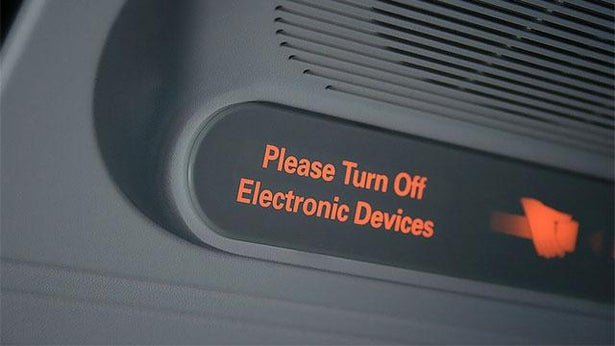 Electronic devices on planes: FAA regulations may soon permit devices below 10,000 feet.