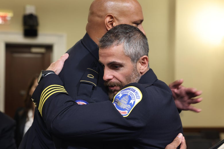 Dunn and Fanone embrace in the hearing room.