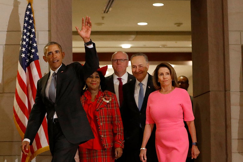 Obama waves while walking ahead of the group of legislators.