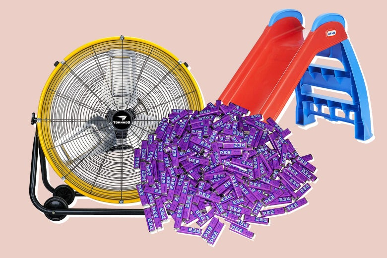 A pile of grape Pez candy, a large fan, and a plastic slide.