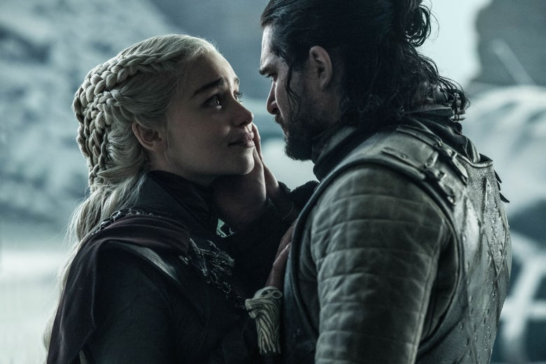 Daenerys Targaryen and Jon Snow embrace in the throne room.